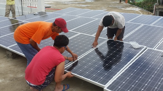 Solar panels being fitted to Batanes General Hospital.
